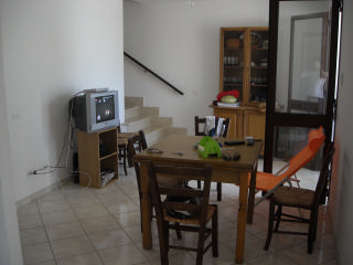Dining room furnished with TV. <br /> Outside wide entrance where to park cars and motorcycles. Moreover, it is also a garage for parking and indoor bike.