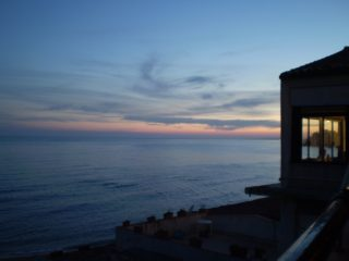 A magical sunset of Selinunte with a view to the Acropolis as seen from the hall of Déjà Vu, which overlooks the sea.