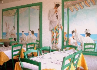 The Hall and the tables of the restaurant with behind depicted the image of Pierrot which invites to silence while eating