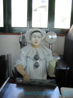 The figure of Pierrot that provides useful information to customers of the restaurant